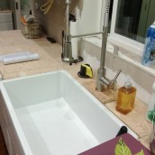 The sink area ready for use; we covered the gap between the sink and plywood with corkboard contact paper to protect the plywood from getting too wet - sparrowsoirees